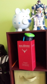 The Dalmore Cigar Malt is home to various knick-knacks, topped off with some electronic toy.